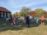 Golf-erster Schlägerkontakt